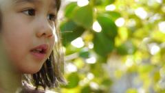 Adorable Little Girl In A Garden Stock Footage