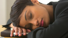 Close up of African American business woman sleeping in office Stock Footage