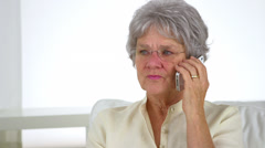 Old woman talking on phone Stock Footage