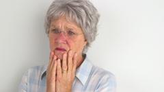 Old woman feeling sad Stock Footage
