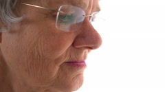 Closeup of old woman looking down - stock footage