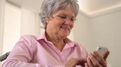 Happy grandma using smartphone Stock Footage