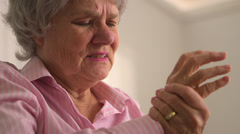 Old woman experiencing arthritis Stock Footage
