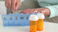 Senior woman separating pills Stock Footage