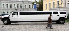 grandmother and white limousine - stock photo