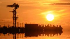 Time Lapse Sunset with Silhouettes of Crane and Workers Stock Footage