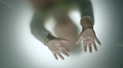 Hands knocks in blured glass Stock Footage