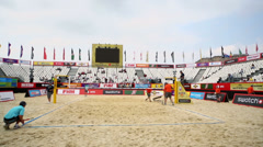 People prepare beach volleyball pitch during tournament Stock Footage