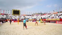 Females teams play beach volleyball on court during tournament Stock Footage
