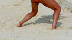 Legs of sportswoman which plays beach volleyball on sand pitch Stock Footage