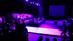 People wait for beginning of fashion show Stock Footage
