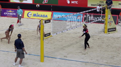 Sportswomen play beach volleyball during championship Stock Footage
