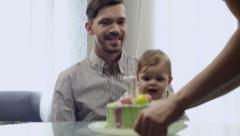 Mommy father and child first birthday party - stock footage