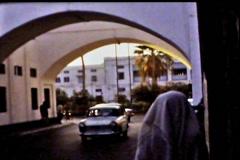 Bahrain traffic under arch Bab al vintage film 1960 SD D001 Stock Footage