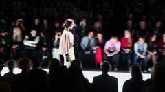Girl walks by podium during Mercedes-Benz Fashion Week Stock Footage