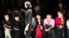 Model goes by podium during Mercedes-Benz Fashion Week Stock Footage