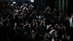 Photographers work in dark during Mercedes-Benz Fashion Week Stock Footage