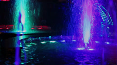 Colorful illumination flashes in fountain with many jets Stock Footage
