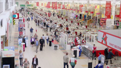 people pay for purchases at cashoffice in Auchan hypermarket - stock footage