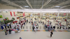 Customers make purchases in Auchan hypermarket Stock Footage