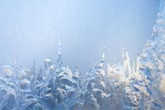 painting on the frozen window by frost - nobody - stock photo