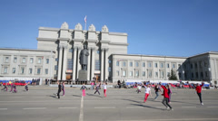 Children dance on square of Kuibyshev near Academic theater Stock Footage