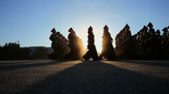Servicemen with flag march during parade rehearsal Stock Footage