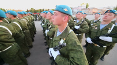 Soldiers in camouflage and berets turns during parade rehearsal Stock Footage