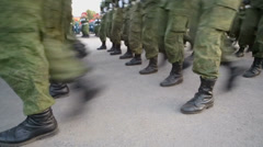 Soldiers in camouflage marching with rifles during parade Stock Footage
