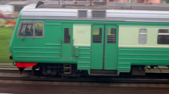 Last coach of passengers train which rides by industrial zone Stock Footage