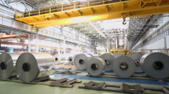 Workshop with overhead crane and rolls of aluminum Stock Footage