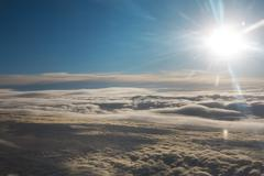 bright sun over the clouds - stock photo