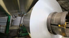Aluminum sheet uncoils from roll on special machines - stock footage