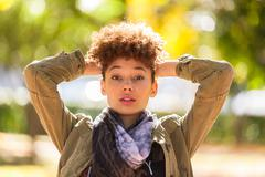 autumn outdoor portrait of beautiful african american young woman - black peo - stock photo