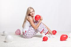 Stock Photo of blonde woman with balloons