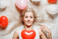 blonde woman with balloons - stock photo