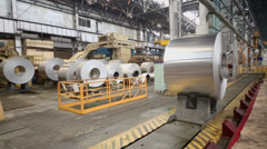 Transporter moves big roll of aluminum at metallurgical plant - stock footage
