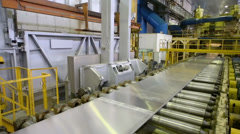 Aluminum sheet moves on pressing machine of rolling mill - stock footage