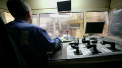 Worker operates with control units of aluminum rolling process Stock Footage