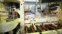 Special pressing machine runs in production shop of rolling mill Stock Footage