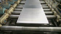 Aluminum sheet moves on transporter of rolling mill in workshop - stock footage
