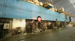 Steam goes from big press machine of rolling mill at workshop Stock Footage