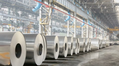 Many rolls of aluminum stored in workshop of metallurgical plant - stock footage