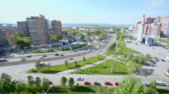 Cityscape with traffic near monument of rocket Soyuz Stock Footage
