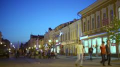 People walk by pedestrian zone of Leningradskaya street Stock Footage