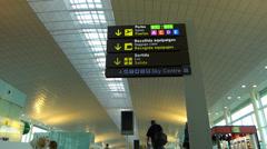 Spain Catalonia passenger passing in Barcelona el Prat Airport Stock Footage