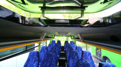 Soft seats for passengers inside saloon of empty city bus Stock Footage