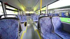 Rows of empty seats inside saloon of empty city bus Stock Footage