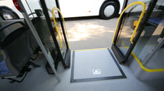 View on closed wheelchair ramp in modern bus during the day Stock Footage