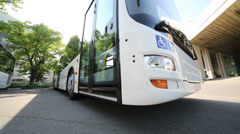 Bus doors opening and closing by driver from inside Stock Footage
